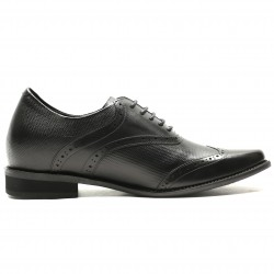 Black elevator shoes with braided leather and brogue detailing