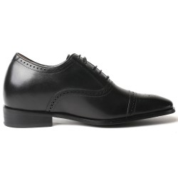 Black elevator shoes with brogue detailing