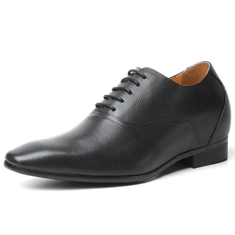 Black elevator shoes with snakeskin pattern